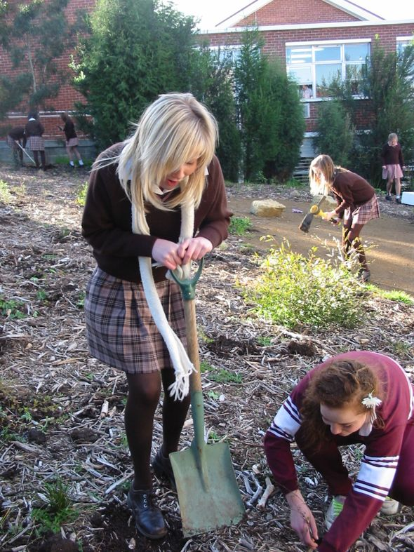 Grade 8 planting trees for National Tree Day © Heather Omant