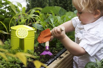 Planting teaches young kids fine motor skills © Planet Ark