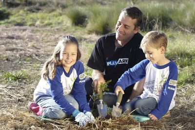 Paul, Jarrah and Maya planting - used for ads © PA owns image