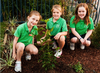 Primary School girls planting tree © Planet Ark